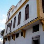 La maison Benjelloun aux portes de l'ancienne médina. En arrière-plan, vue de la nouvelle ville.
